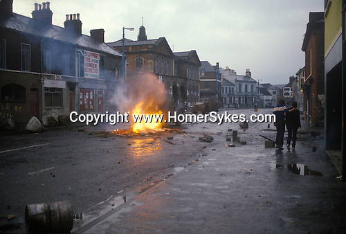 Northern Ireland The Troubles. 1980s. Falls Road,  British army vehicle patrols Catholic area after a riot. 1981