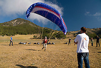 Saint Vincent-les-Forts, Lac de Serre Poncon, France, September 2007. Instructor Roland ter Harkel guide a student into the air.Volantis is home to the paragliding school Inferno. In one week time, students learn to fly the paraglider and earn their mountain licence 1. Photo by Frits Meyst/Adventure4ever.com