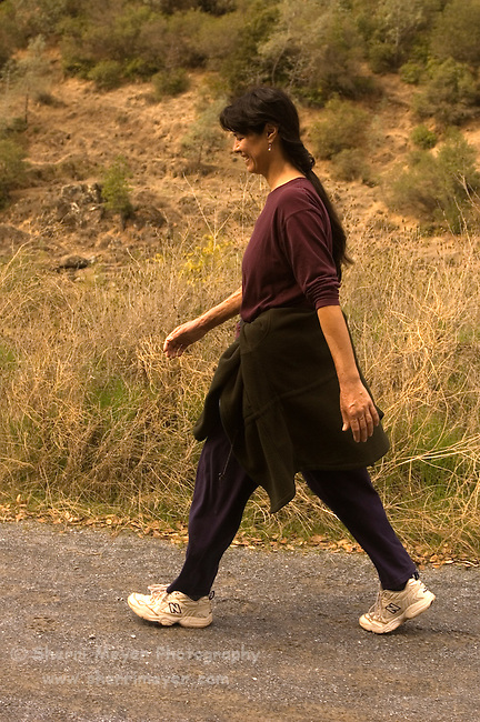Woman walking on the Quarry trail, Auburn State Recreation Area, California