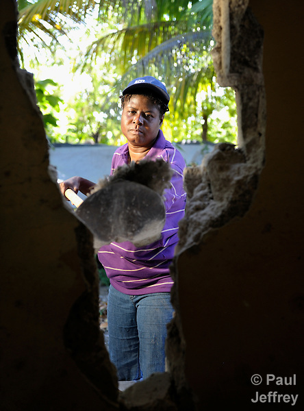 Marie Nela Colas Pierre shovels debris from her earthquake-damaged house in Mellier, Haiti. The dwelling will soon be replaced with a new house provided by the United Methodist Committee on Relief (UMCOR).