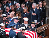 Dignitaries pay their respects as the casket containing the remains of the late former United States President George H.W. Bush at the National funeral service in his honor at the Washington National Cathedral in Washington, DC on Wednesday, December 5, 2018.  Front row: United States President Donald J. Trump, first lady Melania Trump, former US President Barack Obama, former US President Bill Clinton, former US Secretary of State Hillary Rodham Clinton, former US President Jimmy Carter and former first lady Rosalynn Carter. Second row: former US Vice President Dan Quayle, Marilyn Quayle, former US Vice President Dick Cheney, Lynne Cheney. <br /> Credit: Ron Sachs / CNP<br /> (RESTRICTION: NO New York or New Jersey Newspapers or newspapers within a 75 mile radius of New York City)