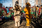 A couple costumed mascots prepare for Chinese New Year's parade in Washington, DC.