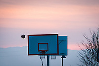 A lone basketball flies toward one of the baskets of the newly installed and upgraded back-to-back backboards  at the San Lorenzo Park, San Lorenzo, California.