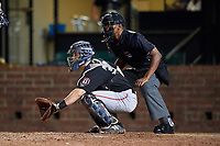 Chattanooga Lookouts catcher Brian Olson (30) waits to receive a pitch in front of home plate umpire Edwin Moscoso during a game against the Mobile BayBears on May 5, 2018 at Hank Aaron Stadium in Mobile, Alabama.  Chattanooga defeated Mobile 11-5.  (Mike Janes/Four Seam Images)