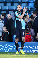Michael Harriman of Wycombe Wanderers applauds the home fans after the Sky Bet League 2 match between Wycombe Wanderers and Mansfield Town at Adams Park, High Wycombe, England on 25 March 2016. Photo by David Horn.