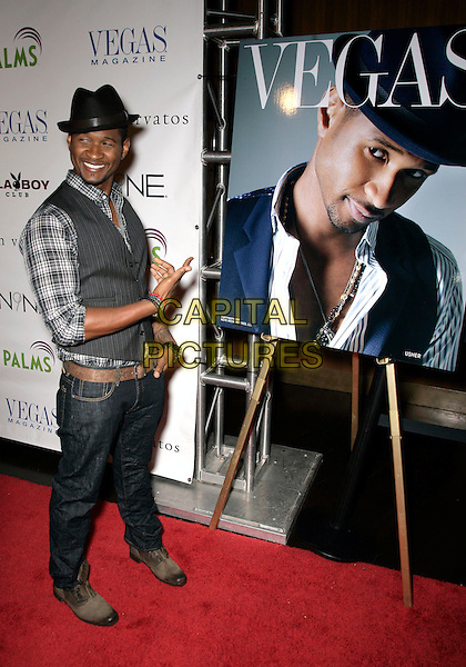 USHER RAYMOND .Vegas Magazine's July/August issue party at The Playboy Club in the Palms  Resort Hotel and Casino, USA, Las Vegas, Nevada, USA, .7th August 2009..full length plaid checked shirt grey gray waistcoat hat jeans denim finger gesture poster cover pointing shoes belt brown trilby pinstripe .CAP/ADM/MJT.©MJT/Admedia/Capital Pictures