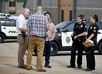 Members of the Springdale Police Department respond Tuesday, June 23, 2020, to the scene of a shooting at 1299 Electric Avenue in Springdale. The department received a call at 1:43 p.m. that a female was shot at that location according to Lt. Jeff Taylor. The first officer arrived on the scene and found a female, approximate age middle 30's, with a gunshot wound to the head laying in the parking lot. She was transported to a hospital with life threatening injuries Taylor said. Taylor said that there are no suspects at this time. Check out nwaonline.com/200624Daily/ and nwadg.com/photos for a photo gallery.<br /> (NWA Democrat-Gazette/David Gottschalk)