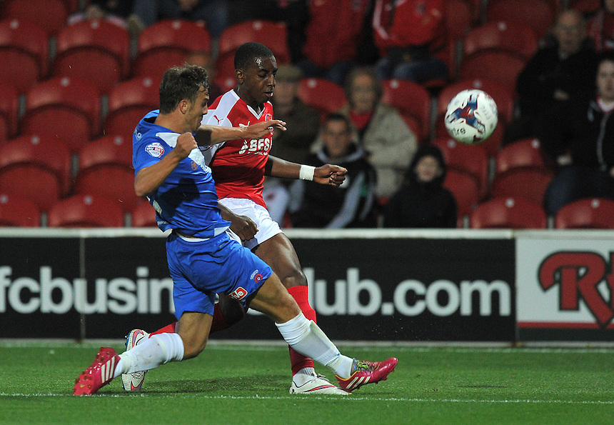 Fleetwood Town's Amari'i Bell battles with Hartlepool United's Michael Duckworth<br /> <br /> Photographer Dave Howarth/CameraSport<br /> <br /> Football - Capital One Cup First Round - Fleetwood Town v Hartlepool United - Tuesday 11th August 2015 - Highbury Stadium - Fleetwood<br />  <br /> &copy; CameraSport - 43 Linden Ave. Countesthorpe. Leicester. England. LE8 5PG - Tel: +44 (0) 116 277 4147 - admin@camerasport.com - www.camerasport.com