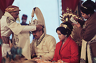 February 24th, 1975. Kathmandu. Nepal. The Coronation of King Birendra and Queen Aishwarya of Nepal, on the chosen day. At 8:37 a.m., the precise moment selected by court astrologers more than a year before, the royal priest placed the huge jewel-encrusted crown on the King's head and a diamond tiara atop Queen Aishwarya's. They were both massacred by their son Dipendra  on 1 June 2001.