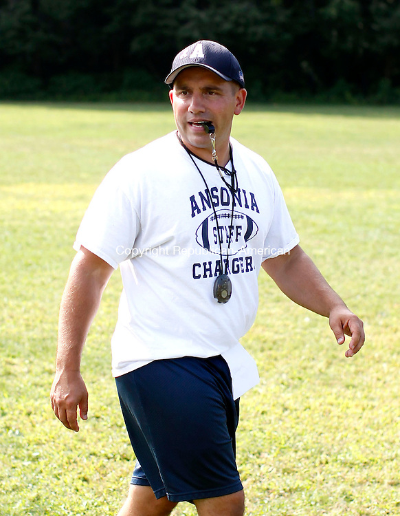 Ansonia, CT- 28 August 2013-082813CM09-  Ansonia head coach, Tom Brockett leads the Chargers during practice in Ansonia Wednesday afternoon.   Christopher Massa Republican-American