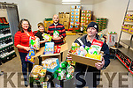 HELPING THOSE IN NEED: Volunteers with the St Vincent de Paul Foodbank have been working flat out this week preparing and delivering food hampers to those in need. Pictured were: Edel Connolly, Eileen Carolan, Ronan Moriarty and Pat Murphy.