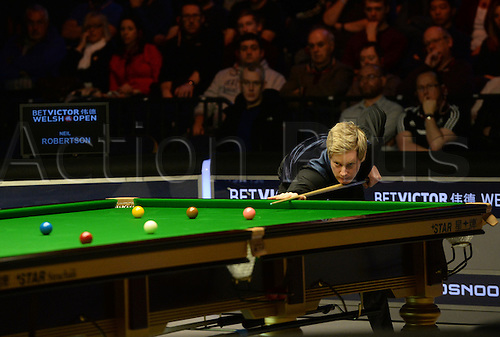 20.02.2016. Cardiff Arena, Cardiff, Wales. Bet Victor Welsh Open Snooker semi-finals. Mark Allen versus Neil Robertson. Neil Robertson attempts a long red.