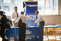 Job seekers attend a job fair in the East Harlem neighborhood of New York on Wednesday, August 15, 2012.  The job fair is one of the many events occurring during the Harlem Week festivities,  (© Frances M. Roberts)