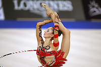 September 21, 2007; Patras, Greece;  Elizabeth Paisieva of Bulgaria turns pirouette (leg behind) with hoop  during All-Around final at 2007 World Championships Patras.  Betty helped Bulgaria to receive the 2nd of 2 positions for the individual All-Around at Beijing 2008 Olympics.  Photo by Tom Theobald. .