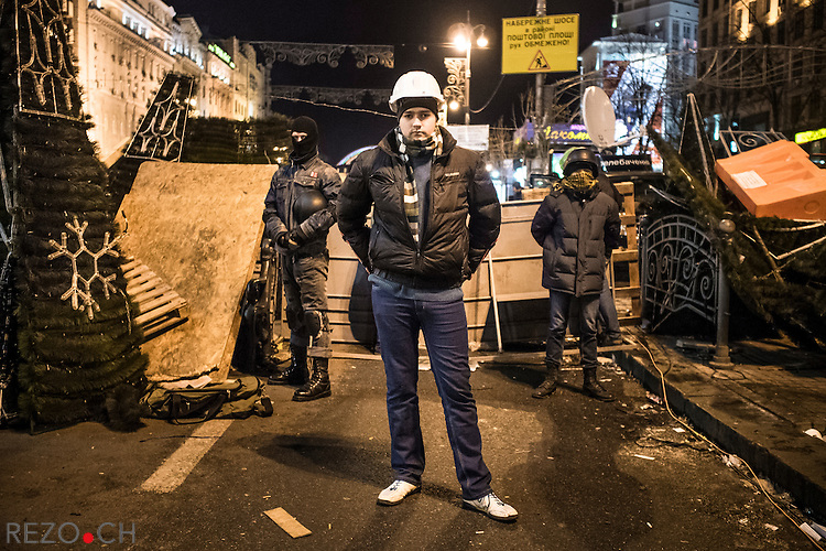 Kiev, Ukraine - 03 december 2013: Michail volunteered to guard one of the barricade blocking the potential police offensive against euromaidan, on his left, Rem, on his right, Illya. Credit: Niels Ackermann / Rezo.ch