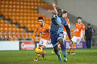 Adebayo Akinfenwa of Wycombe Wanderers holds off Sebastien Des Pres of Blackpool during the The Checkatrade Trophy match between Blackpool and Wycombe Wanderers at Bloomfield Road, Blackpool, England on 10 January 2017. Photo by Andy Rowland / PRiME Media Images.
