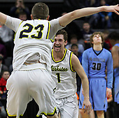 Foster Loyer (1), Clarkston, celebrates with Taylor Currie (23) as a dejected Thad Shymanski (30), Grand Rapids Christian, watches time expire during MHSAA Class A state final basketball action at the Breslin Center in East  Lansing Saturday, March 25, 2017. Clarkston took home their first basketball championship in school history by defeating the previously undefeated Eagles 75-69. (Photo: Larry McKee, L McKee Photography)
