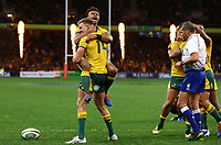Reece Hodge of the Wallabies celebrates scoring a try with Will Genia of the Wallabies during the Rugby Championship match between Australia and New Zealand at Optus Stadium in Perth, Australia on August 10, 2019 . Photo: Gary Day / Frozen In Motion