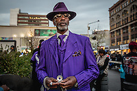 NEW YORK APRIL 25: A man dress in purple to honor Prince.Thousands gathered at Harlem's 125th Street to dance, celebrate and honor the life of Prince Monday evening. The free event took place at the plaza of the Harlem State Building located at 125th Street and Adam Clayton Powel Jr. The pop star died on Thursday at the age of 57. in Harlem, New York City, Monday 25, 2016.Photo by VIEWpress/Maite H. Mateo