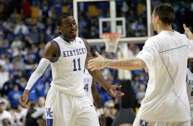 Mark Krebs walks out to hug freshman John Wall after he made a shot in overtime of UK's win 75-74 over Mississippi State  Bridgestone Arena in the SEC Finals on Sunday, March 14, 2010. Photo by Britney McIntosh | Staff