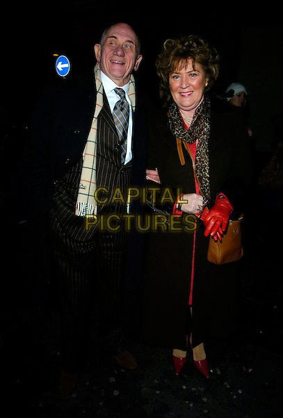 "JOHN BARDON & GUEST.""Guys & Dolls"" VIP Performance, Picadilly Theatre, London, UK..January 24th, 2007.full length brown pinstripe suit scarf burberry black coat.CAP/CAN.©Can Nguyen/Capital Pictures"