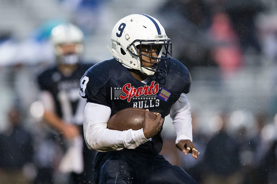 Petey Reaves (9) of the Hickory Ridge Ragin' Bulls runs with the football during first half action against the East Rowan Mustangs at Hickory Ridge High School on October 2, 2015 in Harrisburg, North Carolina.  The Ragin' Bulls defeated the Mustangs 20-7.  (Brian Westerholt/Sports On Film)