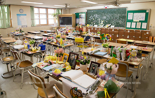 Sewol Ferry Disaster, May 22, 2016 : Flowers, letters and pictures to offer condolences for the students and teachers who died in the Sewol ferry disaster in 2014, are seen in a classroom of Danwon High School in Ansan, south of Seoul, South Korea. The bereaved families of the student victims recently agreed with other parents at the school to move the classrooms of the victims to a permanent commemorative classroom out of the school instead of leaving them unused. The classrooms at the school have been preserved the way they were since the Sewol ferry sank in waters off the country's southwestern coast on April 16, 2014, leaving 304 people dead. Most of the victims were the students from the school on a field trip to Jeju island. (Photo by Lee Jae-Won/AFLO) (SOUTH KOREA)