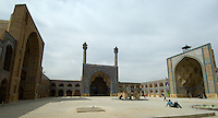 The Jameh (Friday) Mosque in Isfahan, Iran, incorporates 800 years of Islamic architecture. The south eivan and the two minarets in the centre of the picture date from the 14th century Mongol era, while the west eivan to the right was originally built by the Seljuks in the 12th century but later decorated by the Safavids in the 16th century. The two storey porches round the courtyard's perimeter were constructed in the late 15th century. The ablutions fountain in the centre of this main courtyard was designed to imitate the Kaaba at Mecca.