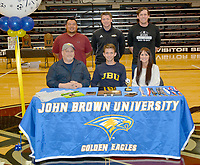 Graham Thomas/Siloam Sunday<br /> Siloam Springs senior forward Eli Jackson signed a letter of intent Wednesday to play soccer at John Brown University. Pictured are: Front from left, father Travis Jackson, Eli Jackson, mother Monica Jackson; back, assistant coach Ehldane Labitad, JBU men's soccer coach Brenton Benware and Siloam Springs boys soccer coach Luke Shoemaker.