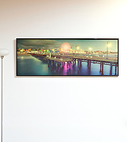 "Santa Monica Pier by Bill Brewer. Digital Print on Panel. Framed. 27"" x 73.5"",  Santa Monica Pier, California, in the evening with a lit Ferris Wheel"