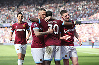 West Ham United's Michail Antonio celebrates scoring his side's first goal with Marko Arnautovic and Declan Rice<br /> <br /> Photographer Rob Newell/CameraSport<br /> <br /> The Premier League - West Ham United v Leicester City - Saturday 20th April 2019 - London Stadium - London<br /> <br /> World Copyright © 2019 CameraSport. All rights reserved. 43 Linden Ave. Countesthorpe. Leicester. England. LE8 5PG - Tel: +44 (0) 116 277 4147 - admin@camerasport.com - www.camerasport.com