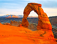 Delicate Arch at Sunset with La Sal Mountains Beyond, Freestanding Arch of Entrada Sandstone, Arches National Park, Utah <br /> <br /> <br /> October