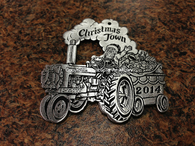 BETHLEHEM, CT - 5 Dec 2014 - 120514RH02 - The 2014 pewter Christmas Town Festival collectible ornament will be sold today at the festival in Bethlehem and at Town Hall until supplies last. Rick Harrison Republican-American