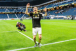 ****BETALBILD**** <br /> Solna 2015-04-26 Fotboll Allsvenskan AIK - &Ouml;rebro SK :  <br /> AIK:s Nils-Eric Johansson sjunger med AIK:s supportrar efter matchen mellan AIK och &Ouml;rebro SK <br /> (Foto: Kenta J&ouml;nsson) Nyckelord:  AIK Gnaget Friends Arena Allsvenskan &Ouml;rebro &Ouml;SK jubel gl&auml;dje lycka glad happy glad gl&auml;dje lycka leende ler le supporter fans publik supporters