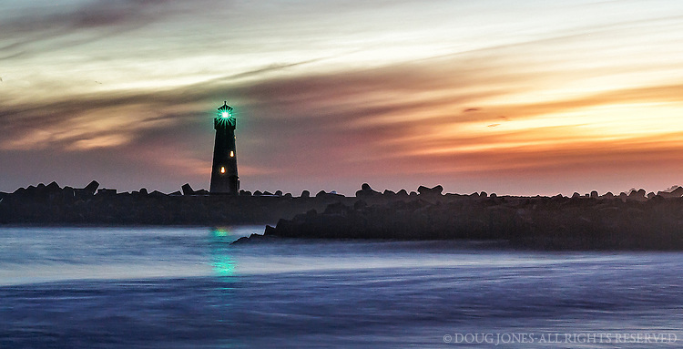 The Walton LIghthouse stands at the entrance of the Santa Cruz Small Craft Harbor.  This shot was taken just after sunset and soon after the light was activated.