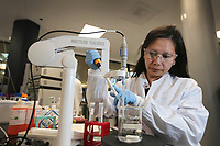 Feb. 21, 2019. San Diego, CA. USA   Jasmine Nguyen Senior Research Associate at Synthorx checks Ph levels in the companies lab.  Photos by Jamie Scott Lytle. Copyright.