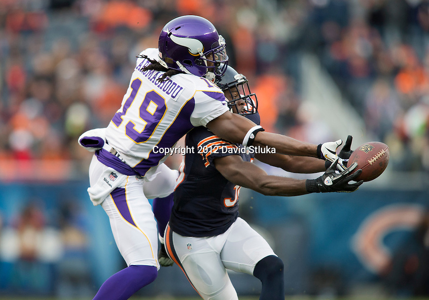 Chicago Bears defensive back Zackary Bowman (38) breaks up a pass intended for Minnesota Vikings wide receiver Devin Aromashodu (19) during a Week 12 NFL football game Sunday, November 25, 2012 in Chicago. The Bears won 28-10. (AP Photo/David Stluka)
