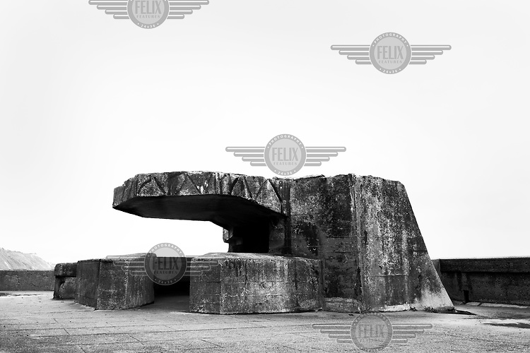 A concrete bunker used by the German Army in WWII is visible along the sea front in northern France along the route of the Atlantic Wall (Atlantikwall in German).The Atlantic Wall (or Atlantikwall in German) was a system of defensive structures built by Nazi Germany between 1942 and 1945, stretching over 1,670 miles (2,690 km) along the coast from the North of Norway to the border between France and Spain at the Pyrenees. The wall was intended to repulse an Allied attack on Nazi-occupied Europe and the largest concentration of structures was along the French coast since an invasion from Great Britain was assumed to be most likely. Slave labour and locals paid a minimum wage were drafted in to supply much of the labour. There are still thousands of ruined structures along the Atlantic coast in all countries where the wall stood except for Germany, where the bunkers were completely dismantled.