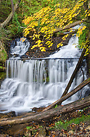 Wagner Falls flows in autumn at Wagner Falls State Scenic Area in Alger County near Munising in Michigan's Upper Peninsula