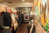 Mark Chambers and Sara Morsey take in the artwork of Lennie Jones at Arts for ACT during Art Walk in Downtown Fort Myers River District, Fort Myers, Florida, USA, March 1, 2013. Photo by Debi Pittman Wilkey