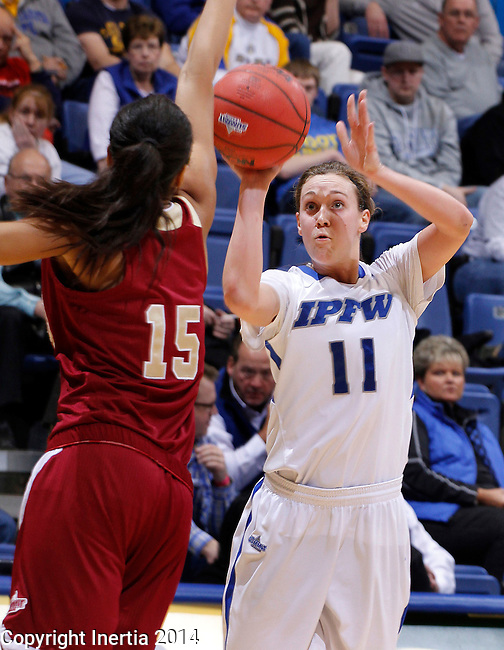SIOUX FALLS, SD - MARCH 9:  Amanda Hyde #11 of IPFW shoots over Denver defende Alecia Espinoza #15 during their quarterfinal game at the 2014 Summit League Basketball Championships Sunday at the Sioux Falls Arena.  (Photo by Dick CarlsonInertia)