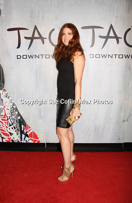 Debra Messing at TAO Downtown Grand Opening NYC on September 28, 2013 in New York City, New York.  (Photo by Sue Coflin/Max Photos)