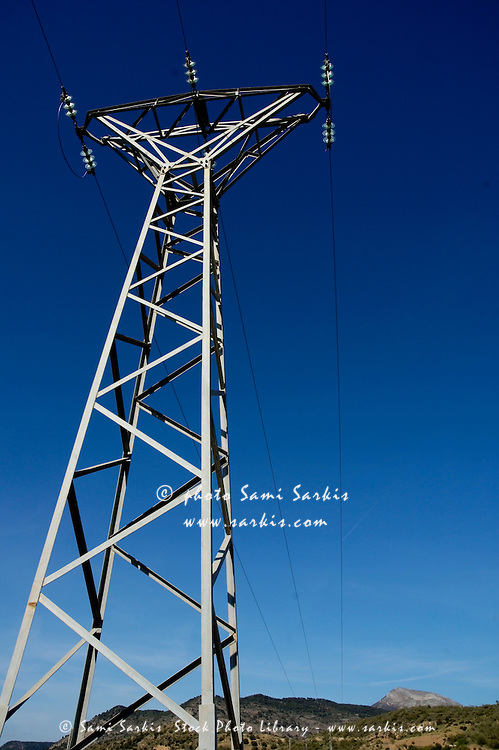 Electricity pylon in the countryside, Andalusia, Spain.