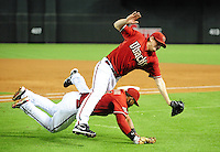 Jun. 1, 2011; Phoenix, AZ, USA; Arizona Diamondbacks pitcher Daniel Hudson (top) collides with first baseman Juan Miranda as they both attempt to catch a foul pop in the third inning against the Florida Marlins at Chase Field. Mandatory Credit: Mark J. Rebilas-