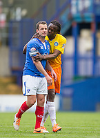 Marcus Bean of Wycombe Wanderers holds onto Michael Doyle of Portsmouth during the Sky Bet League 2 match between Portsmouth and Wycombe Wanderers at Fratton Park, Portsmouth, England on 23 April 2016. Photo by Andy Rowland.