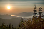 Idaho, North, Coeur d'Alene, Bayview. Summer sunset over Lake Pend Oreille from high in the Coeur d'Alene Mountains of the Kaniksu National Forest.