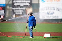 A member of the Ogden Raptors grounds crew readies the field before the game against the Orem Owlz in Pioneer League action at Lindquist Field on June 27, 2017 in Ogden, Utah. Ogden defeated Orem 14-5. (Stephen Smith/Four Seam Images)
