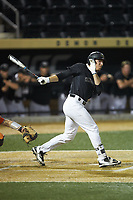 Nick DiPonzio (7) of the Wake Forest Demon Deacons follows through on his swing against the Virginia Cavaliers at David F. Couch Ballpark on May 18, 2018 in  Winston-Salem, North Carolina.  The Cavaliers defeated the Demon Deacons 15-3.  (Brian Westerholt/Four Seam Images)