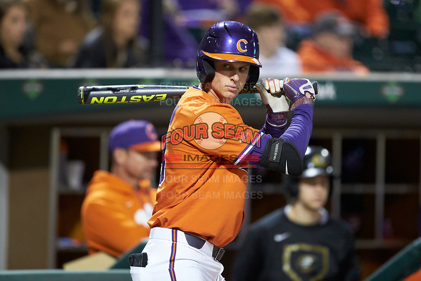Logan Davidson (8) of the Clemson Tigers waits for his turn to bat during the game against the Charlotte 49ers at BB&T BallPark on March 26, 2019 in Charlotte, North Carolina. The Tigers defeated the 49ers 8-5. (Brian Westerholt/Four Seam Images)