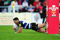 Jeff Williams of Bath Rugby dives for the try-line. Pre-season friendly match, between the Scarlets and Bath Rugby on August 20, 2016 at Eirias Park in Colwyn Bay, Wales. Photo by: Patrick Khachfe / Onside Images
